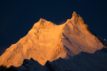 Manaslu Peak -  the eighth highest mountain in the world. Nepal, Himalayas, Manaslu restricted area, sunrise above Manaslu peak 8,156 m. Stock Photo