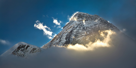 mount: The peak of the highest mountain in the world - Mt. Everest in the light of the first sunrays.