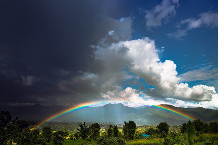 Bright rainbow after the heavy rain. Stock Photo