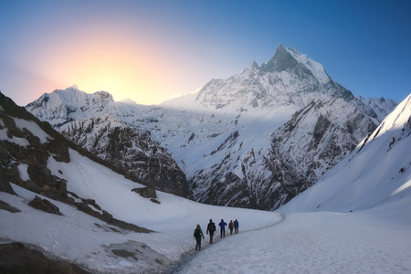 A group of trekkers are walking in the mountains. Nepal, Himalayas, Annapurna region.