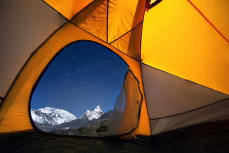 View of the mountains from a tourist tent. From the «window» of the tent from left to right there are two eight-thousanders - Mt. Everest (8,848 m), Lhotse (8,516 m) and Ama Dablam (6,814 m).