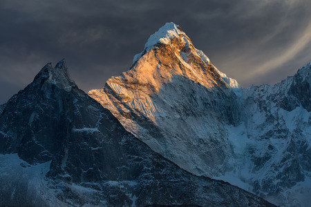 Majestic snowy mountain peak - Ama Dablam (6,812 m) is a one of the most beautiful and impressive peaks of our planet.