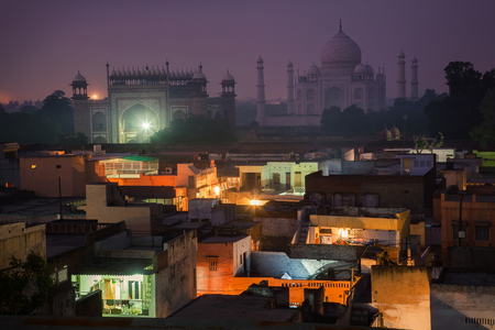 In the shadow of the endless beauty of Taj Mahal. Stock Photo