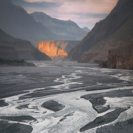 Nepal, Upper Mustang, the last sunrays in the gorge of Kali Gandaki river, the deepest gorge in the world Standard-Bild