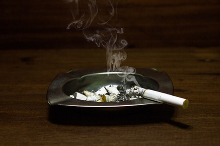 Ashtray and cigarettes, abstract background for World No Tobacco Day concept.