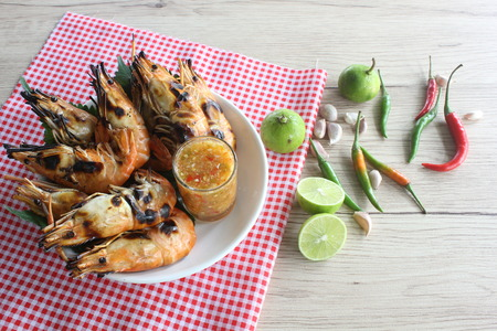 Grilled lobster with seafood sauce and ingredients.