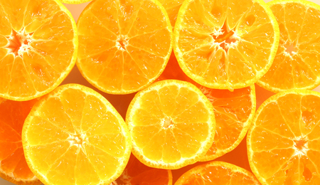 Thin slice of orange, stacked as a backdrop. Stock fotó