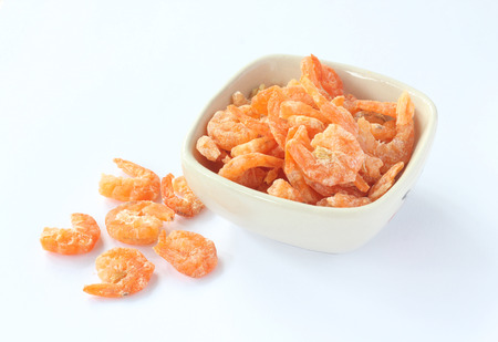 Dried shrimp in a bowl on white background. Stock fotó