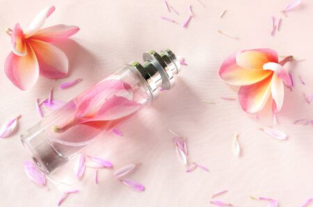 Perfume and beautiful flowers on sweet background. Stock fotó