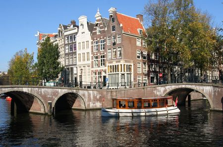 Historical touringboat in an Amsterdam canal Stock Photo - 3295693
