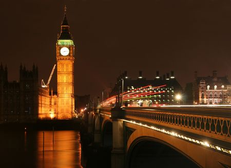 Big Ben and Westminster bridge at night, with trail of lights due to long exposure photo
