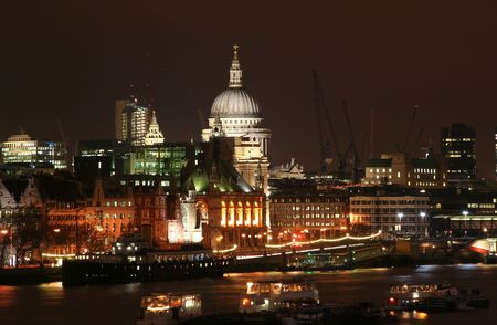St. Pauls cathedral at night seen from across the Thames photo
