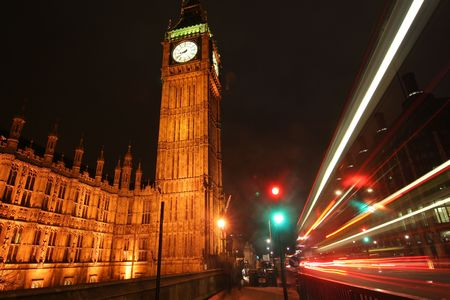 Big Ben with nighttrime traffic trails of light photo