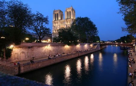 notre dame: Notre Dame cathedral in Paris at night Stock Photo