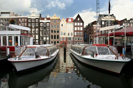 tour boats: Tour boats and ticket office in Amsterdam canal Stock Photo