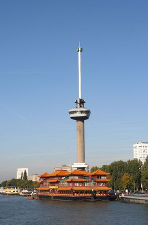 Euromast in Rotterdam with floating Chinese restaurant in front