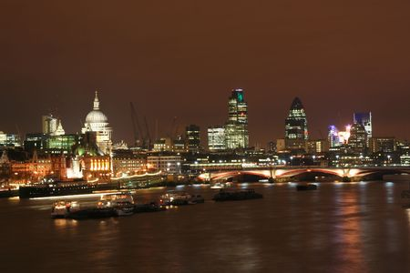 city of london: The Thames at night, with St. Pauls cathedral and the City