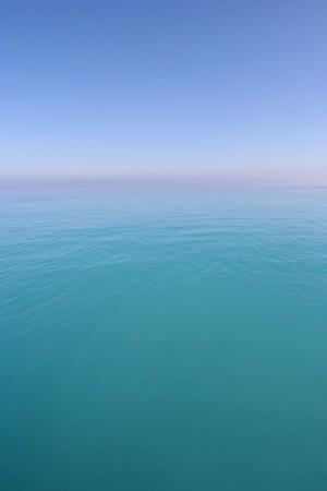 doldrums: Horizon of a calm Mediterranean Sea on a hot day