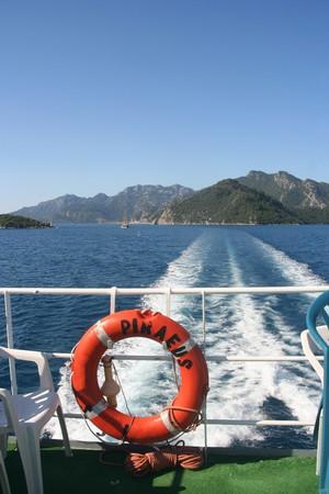 Lifebuoy on the ferry to Piraeus and ship's wake Stock Photo - 4052521