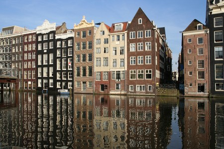 house gables: Canal houses and their reflections in Amsterdam Stock Photo
