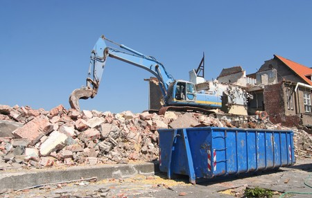 dumpster: Demolition of old buildings during urban renovation Stock Photo