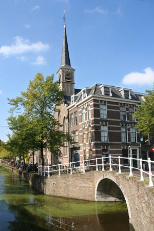 delft: Little church and bridge on a canal in Delft, Holland