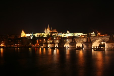 Charles Bridge and Castle of Prague by night photo