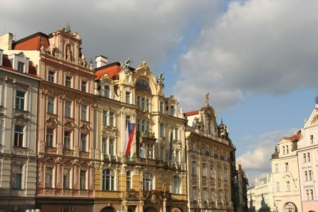 monumental: Monumental houses and Czech flag on Prague Town Square