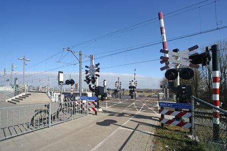 Unguarded railway crossing with lights and signs photo