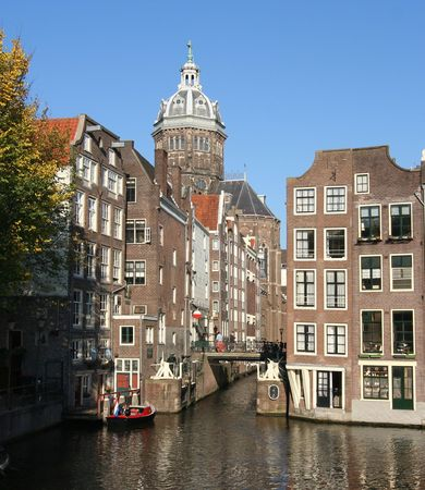 nicolaas: Tower of St. Nicholas church above a canal in Amsterdam