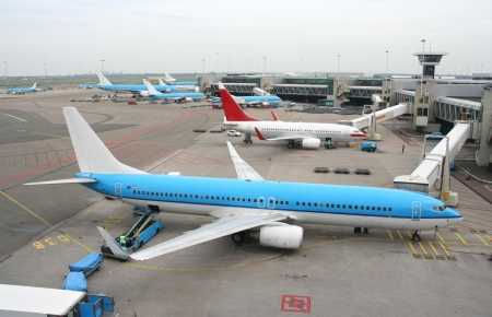 control tower: Airplanes parked at the gateways at the airfield Stock Photo