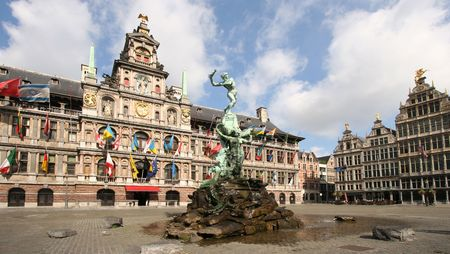 Antwerp market place with City Hall and famous statue and fountain by Brabo