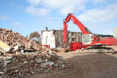 renewal: Demolition bulldozer at urban renewal construction site