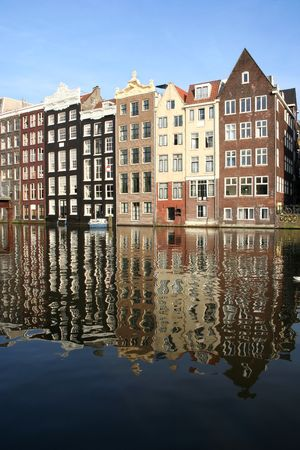 house gables: Amsterdam canal houses reflected in the water