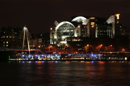 Charing Cross train station and shopping mall at night, across the Thames Stock Photo - 6012163