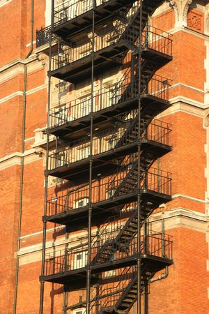 Fire escape on an old apartment building in the afternoon sun photo