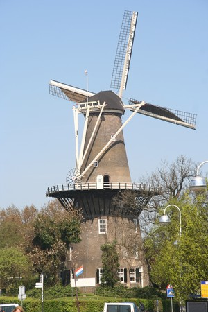 monumental: Monumental Wind Mill in Leiden, Holland, with Dutch flag Stock Photo