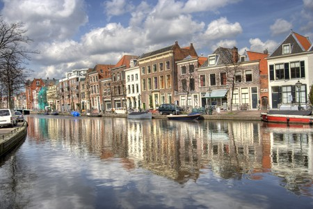 Historical houses along a canal in Leiden, Holland photo