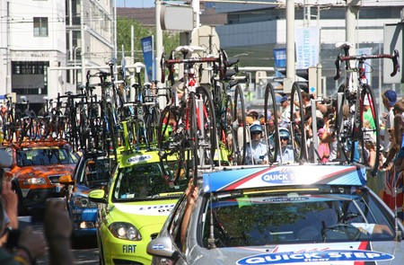 peloton: ROTTERDAM, HOLLAND - JULY 4, 2010: Bikes on top of cars at the first stage of the Tour de France in Rotterdam, Holland on July 4, 2010 Editorial