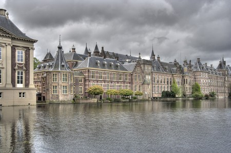 rainclouds: Dutch Parliament buildings Binnenhof in The Hague, Holland with rainclouds Stock Photo