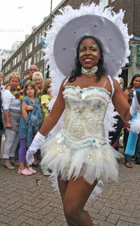 ROTTERDAM, HOLLAND - JULY 31, 2010: Girl at the parade of the annual Summer Carnival in Rotterdam on July 31, 2010 in Rotterdam, Holland Stock Photo - 7525688