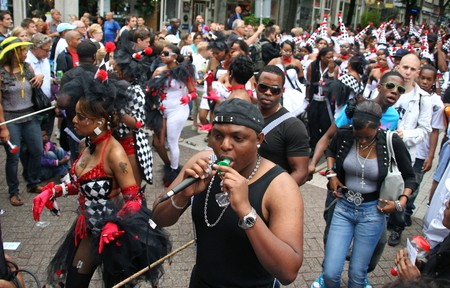 ROTTERDAM, HOLLAND - JULY 31, 2010: Party people in the parade of the annual Summer Carnival in Rotterdam on July 31, 2010 in Rotterdam, Holland Stock Photo - 7525699