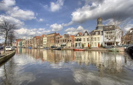 Canal in Leiden, Holland, with houses and church Stock Photo - 7607367