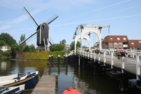 Wind mill and drawbridge in Leiden, Holland photo