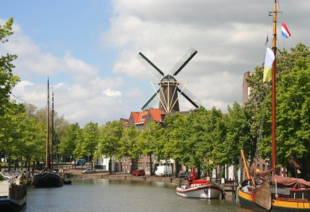 schiedam: Canal, historic boats and windmill in Schiedam, Holland