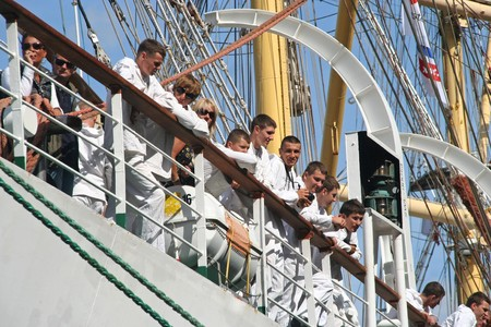 AMSTERDAM, AUGUST 19, 2010: Sailors on the Polish ship Dar Mlodziezy at Sail 2010 in Amsterdam, Holland on august 19, 2010 Stock Photo - 7659986