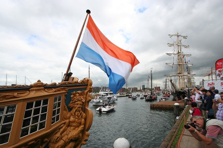 AMSTERDAM, AUGUST 19, 2010: Dutch flag on historic sailing ship at Sail 2010 in Amsterdam, Holland on august 19, 2010