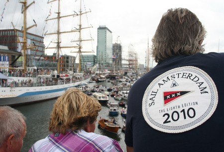 AMSTERDAM, AUGUST 19, 2010: Spectators with Sail T-shirt admire the tall ships at Sail 2010 in Amsterdam, Holland on august 19, 2010 Stock Photo - 7659952