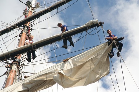 work boat: AMSTERDAM, AUGUST 19, 2010: Sailers in the mast of Dutch tall ship Stad Amsterdam at Sail 2010 in Amsterdam, Holland on august 19, 2010 Editorial