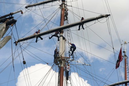 sailingboat: AMSTERDAM, AUGUST 19, 2010: Sailers in the mast of Dutch tall ship Stad Amsterdam at Sail 2010 in Amsterdam, Holland on august 19, 2010 Editorial